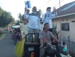 Calon kepala desa Buko Bolmut diarak keliling kampung menggunakan kendaraan viar